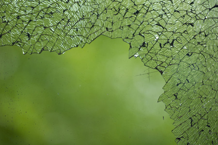 Cracked broken destroyed glass damaged window background 写真素材