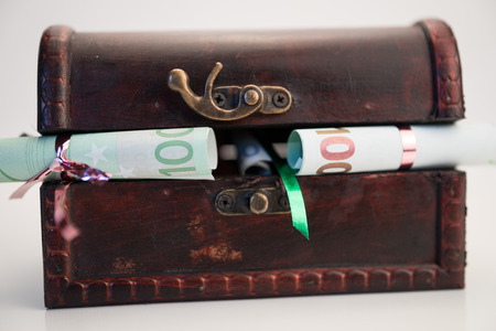 hoard: Wooden chest with Euro currency inside Stock Photo
