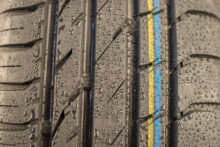 tire tread: Close-up shot of classical tire tread in wet weather condition Stock Photo