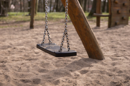 lonliness: Empty swing on children playground