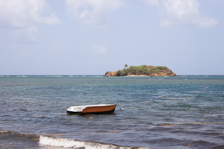 lonesome: A lonesome boat moored in the bay Stock Photo