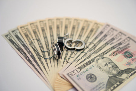 jewlery: American dollars with modern jewelry Stock Photo