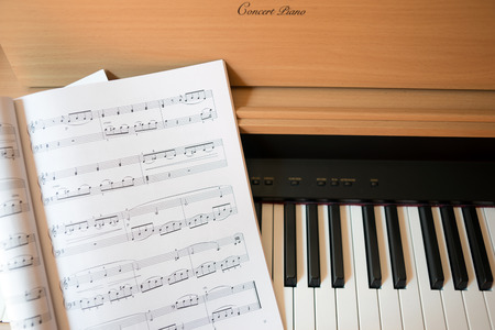 music book: Close up view of piano keyboard and music book