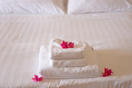 white towels: White towels with flowers in hotel