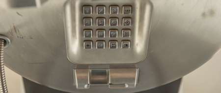 used: dial number button on old used public telephone
