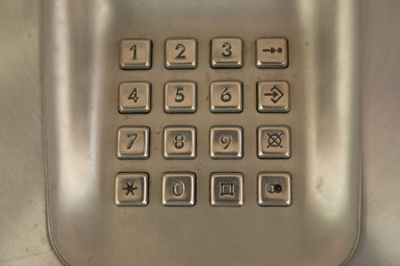 old telephone: dial number button on old used public telephone