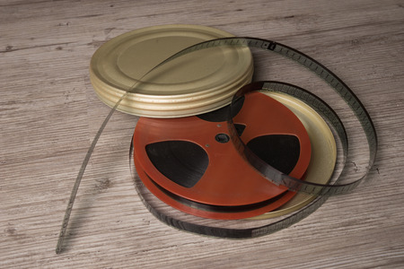 motion picture: Old motion picture film reel with golden can