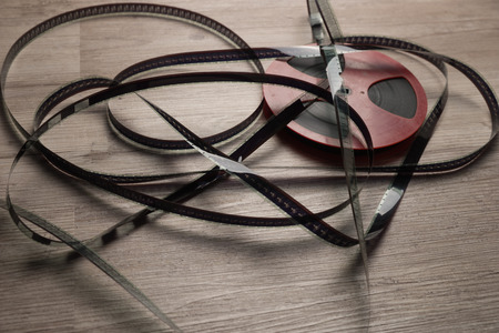 motion picture: Old motion picture film reel on the table