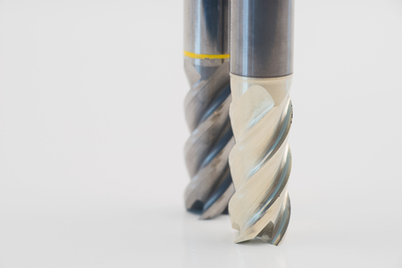 end mill: Silver and golden end mill cutter Stock Photo