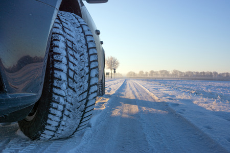 winter tyre: Winter tyre on the road covered with snow