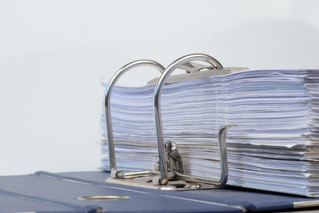filing system: Open folder with documents filed on white background