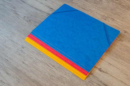 back to school supplies: Folders in different colors.Office background