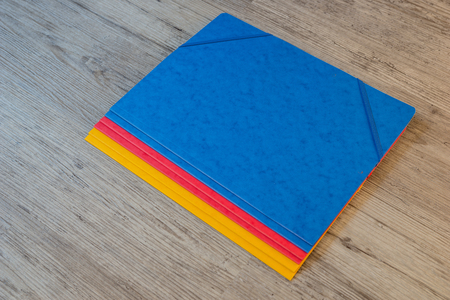 paper stack: Folders in different colors.Office background