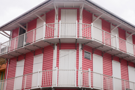 brightly: A brightly painted house on the island Guadeloupe Stock Photo