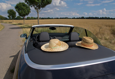 cabriolet: Summer, Sun, Car with two straw hats  in cabriolet