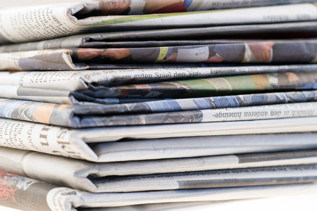 pile of newspapers: Pile of old newspapers, selective focus Stock Photo