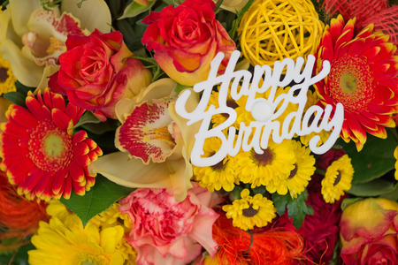 Bunch of colorful flowers, flower bouquet with text Happy Birthday Reklamní fotografie