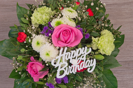 Bunch of colorful flowers, flower bouquet with text Happy Birthday Banco de Imagens