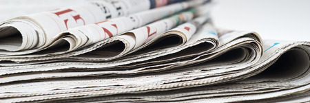 broadsheet: Pile of old newspapers, selective focus Stock Photo