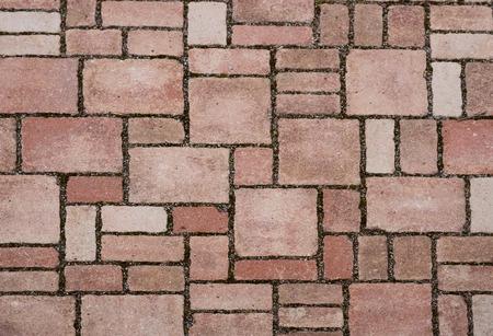 Rote Backsteinpflastersteinen auf einem Bürgersteig