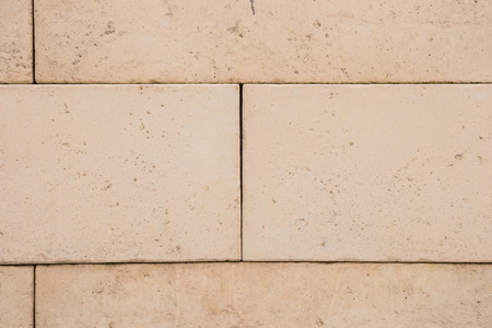 seamless tile: Brown sandstone tile wall texture and background
