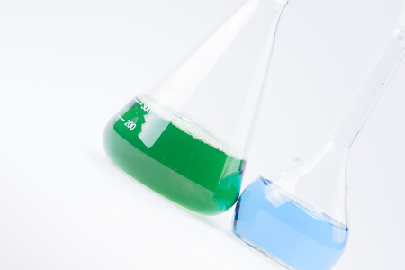 hypothesis: Glass laboratory apparatus with green and blue water