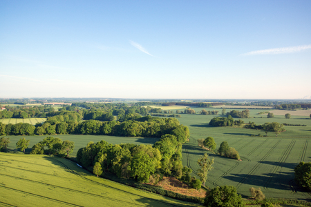 arable land: Cultivated field from above. Aerial view of meadows and cultivated fields. Birds view. Arable land Stock Photo