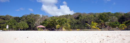 caribbean beach: deserted white sand caribbean beach in Guadeloupe Stock Photo