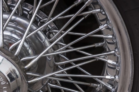 hubcap: Vintage car spoke wheel, old wheel background Stock Photo