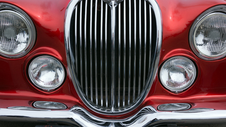 grille': Vintage car detail with red color - chrome grille