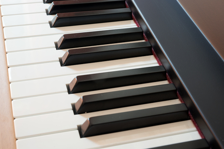 acoustically: Close up of keys on a piano