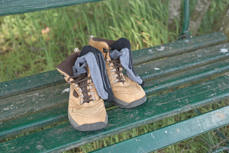 hiking shoes: Hiking shoes with socks on green bench