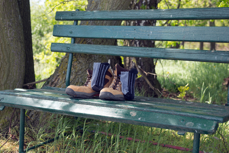 hillwalking: Hiking shoes with socks on green bench