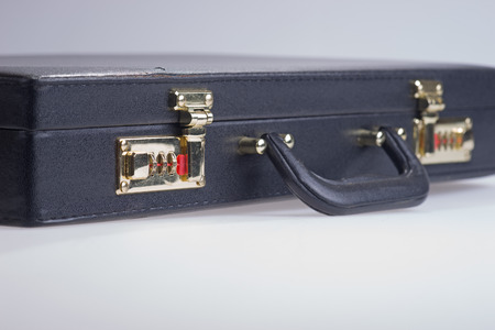 threw: Black Business leather briefcase on white background