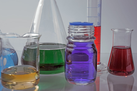 forensics: Glass laboratory apparatus with color water on the table