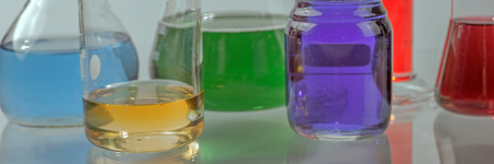 yellow lab: Glass laboratory apparatus with color water on the table