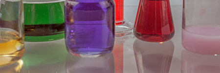hypothesis: Glass laboratory apparatus with color water on the table