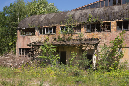 urban decline: abandoned building, outside of abandoned factory building