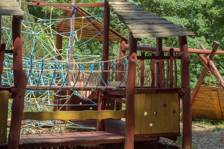 Modern children playground in park, wooden playground Stock Photo