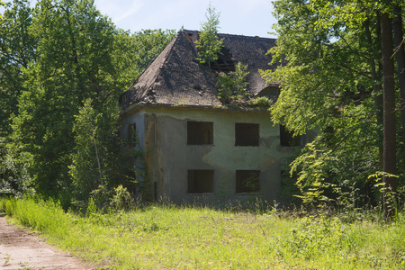 Abandoned building, ruin in the forest, lost places Stock Photo