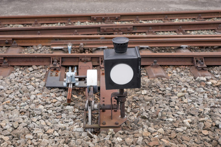 boxcar train: Hand-operated railroad switch with lever, weight and signal