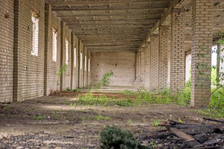 urban decline: Abandoned empty hall of an old factory