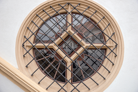 round window: Round window with metal bars in the old house Stock Photo