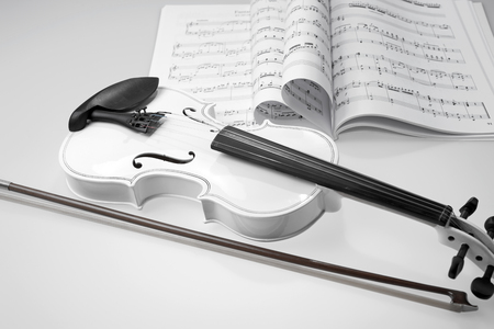 Black and white violin with music notes on white background Stock Photo