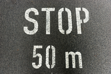 meters: Stop 50 meters on city asphalt on floor