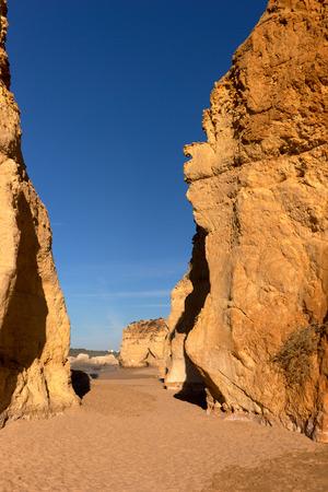 rocha: Early morning on the beach of Praia da Rocha, Portimao Coast. Algarve. Portugal Stock Photo