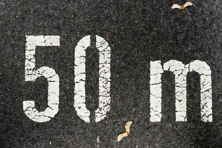 50 meters on city asphalt on floor 写真素材