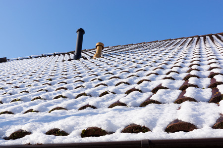 Snow on the roof. Winter scene. Winter background