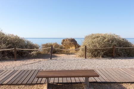 rocha: Wooden Walkway and Picnic bench at the Beach of Praia da Rocha, Algarve