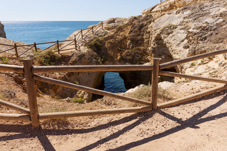 wooden railings: Wooden railings on the cliff at the coast in Portugal, Algarve